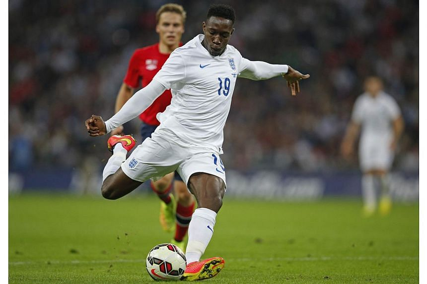 England manager Roy Hodgson said Danny Welbeck had proved his worth at centre-forward after scoring twice in a 2-0 victory over Switzerland in his side's opening Euro 2016 qualifier. -- PHOTO: AFP
