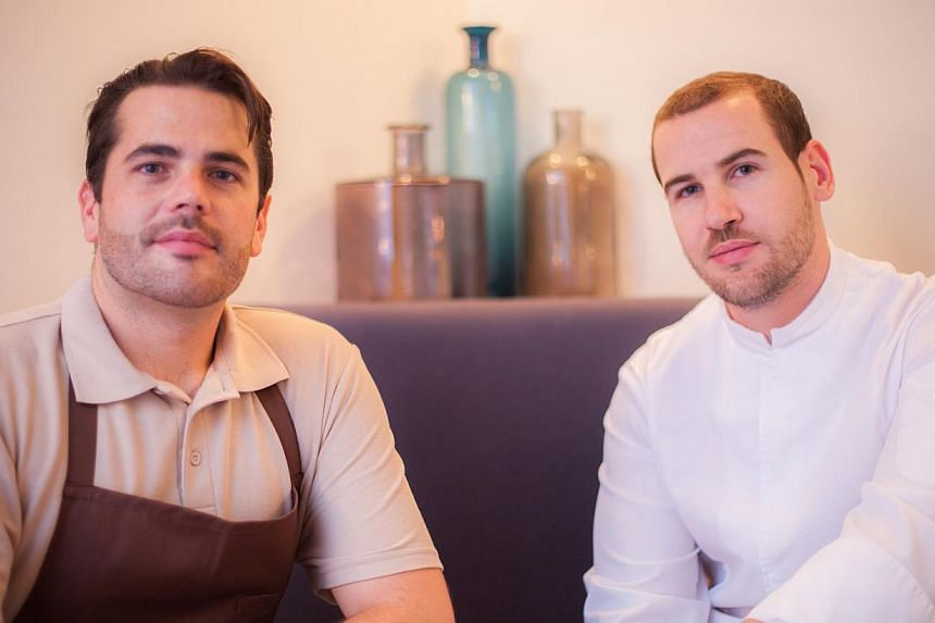 It is run by a lean team, whose members include chef Vincent Crepel (right) and sommelier Thibault Passinge (left). -- PHOTO: PORTE 12