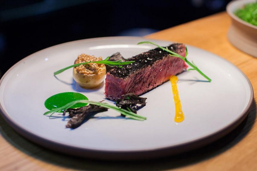 Beef short rib cooked in black tea and served with watercress (above). -- PHOTO: PORTE 12