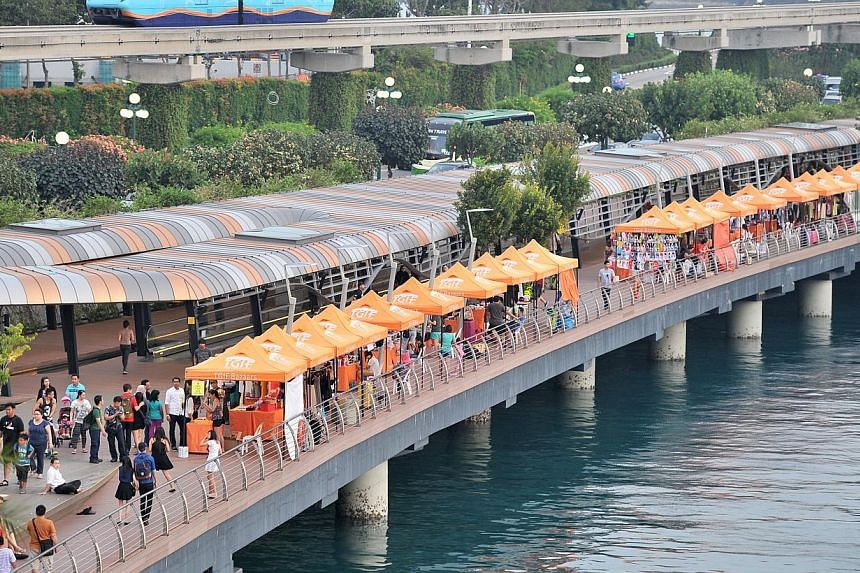 Currently, riders going to Sentosa have to filter into fast-moving car lanes at the end of the Sentosa Causeway Bridge, next to the Sentosa Boardwalk (above).-- PHOTO: ST FILE