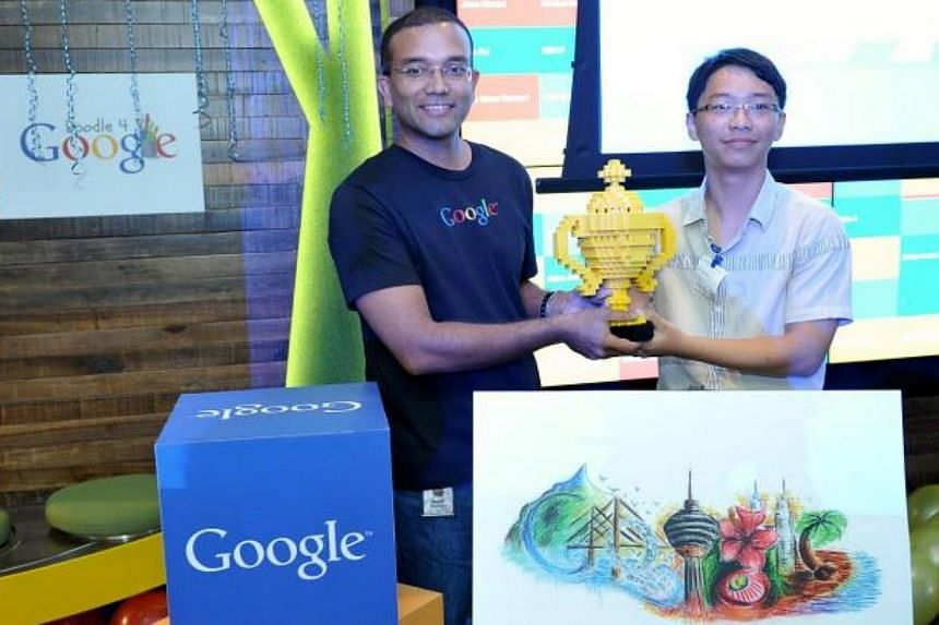 Lee Yee Run, 16, receiving his trophy made out of Lego from Google Malaysia managing director Sajith Sivanandan for his winning doodle, titled Beauty Of Malaysia. -- PHOTO: THE STAR/ASIA NEWS NETWORK