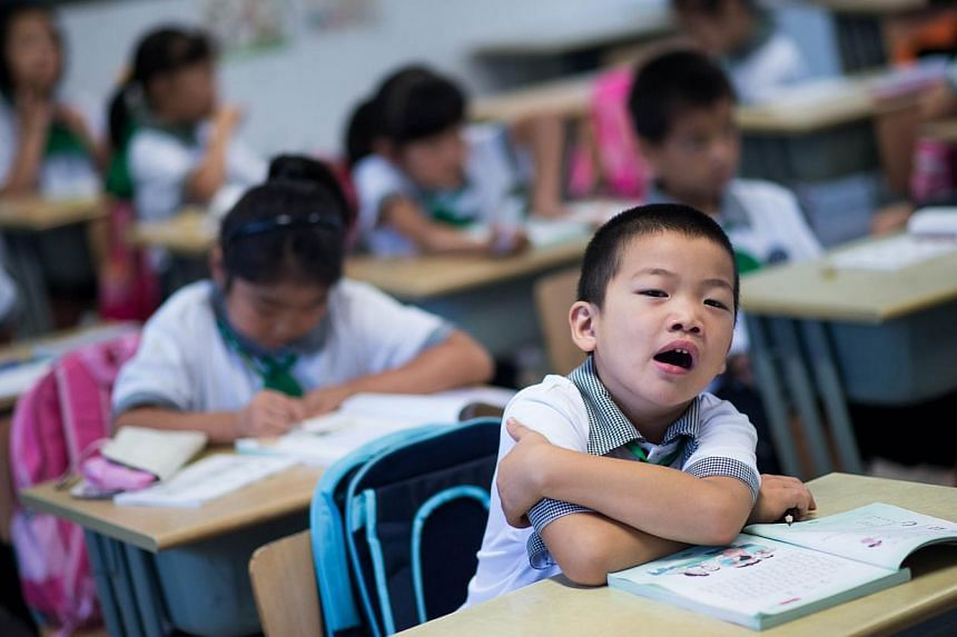 Chinese childen attending a Chinese class at the Jinqao Centre Primary School in Shanghai on Sept 1, 2014.East Asian countries spend relatively limited public budgets for education, saidMr Andreas Schleicher, director of education at the