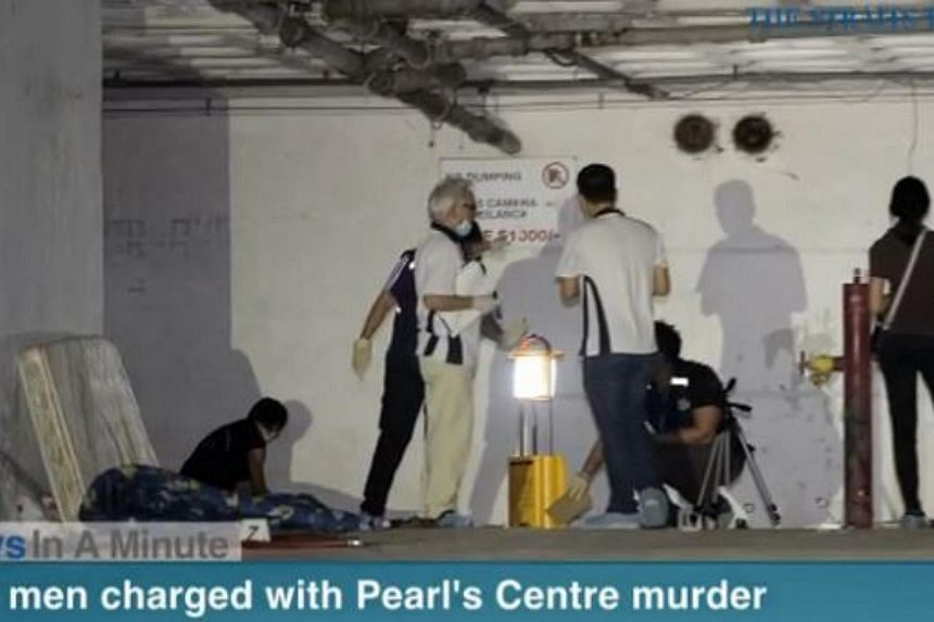 In today's The Straits Times News In A Minute video, two Malaysian men were charged with the murder of another Malaysian at the multi-storey carpark in Pearl's Centre. -- PHOTO: SCREENGRAB FROM RAZORTV VIDEO
