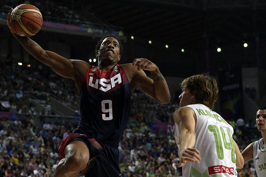 US forward DeMar Derozan (left) vies with Slovenia's guard Jaka Klobucar (right) during the 2014 Fiba World basketball championships quarter-final match Slovenia vs USA at the Palau Sant Jordi arena in Barcelona on Sept 9, 2014. -- PHOTO: AFP