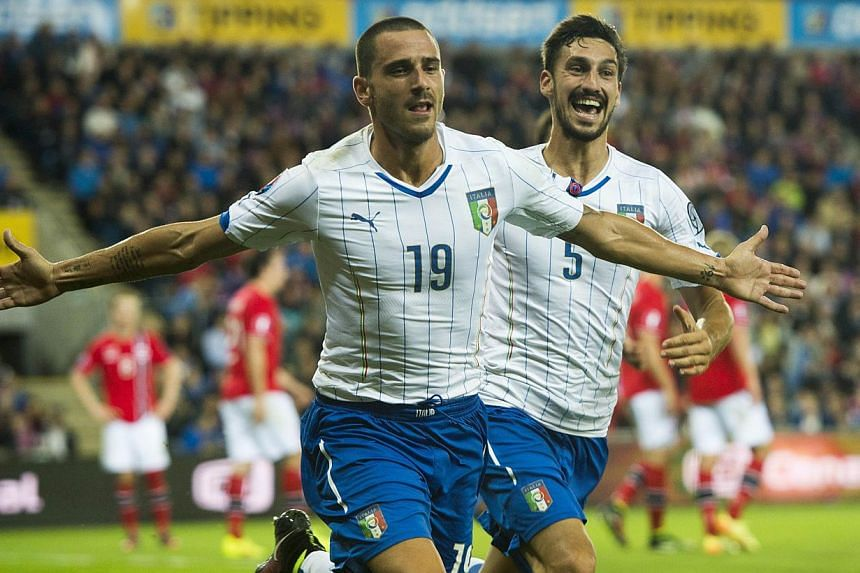 talian players Leonardo Bonucci (left) celebrates scoring the 2-0 goal with his teammate Davide Astori during the Uefa Euro 2016 Group H qualifying football match Norway vs Italy in Osloon Sept 9, 2014. -- PHOTO: AFP