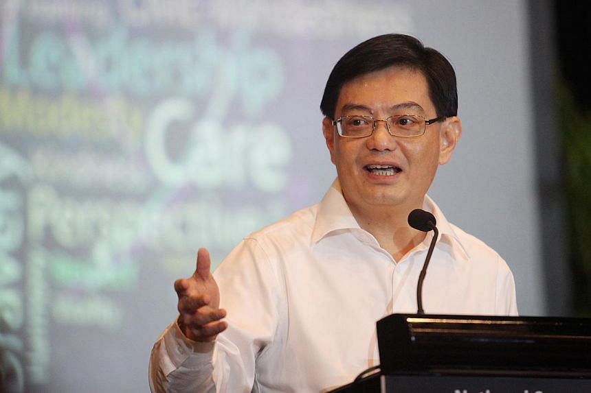 Mr Heng Swee Keat identified three action areas to achieve the desired outcomes. These are: integrate theoretical and applied learning; learn at every stage of your career and in every way; and respect everyone. -- PHOTO: MY