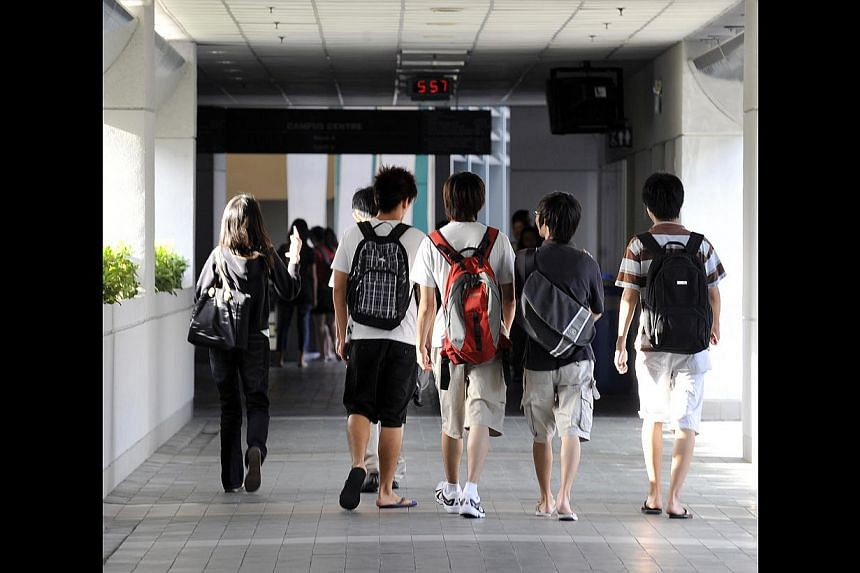 Students, such as these polytechnic students heading to class, should not seek qualifications as a paper chase, says Minister Heng Swee Keat, but rather as a quest for skills. He said the belief that qualifications are all that matter is limiting bec