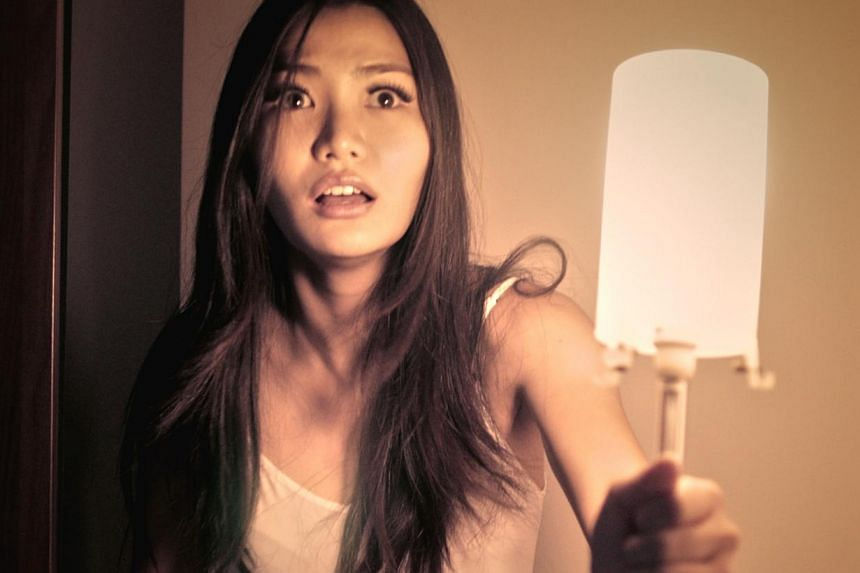 Local model-actress Melissa Faith Yeo stars in local production Afterimages as Amy Tan, who witnesses a suicide and takes a photo of the victim. -- PHOTO:MYTHOPOLIS PICTURES AND CATHAY-KERIS FILMS