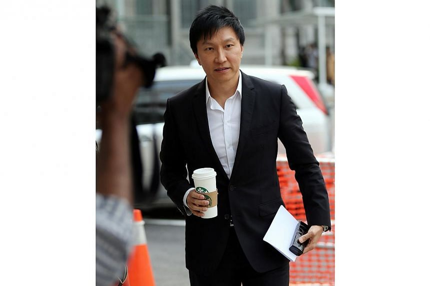 City Harvest Church (CHC) founder Kong Hee at the courts on Sept 11, 2014. Kong choked up a few times on the stand on Thursday as he told the court how investigations into financial irregularities at the church had affected his young son. -- ST PHOTO