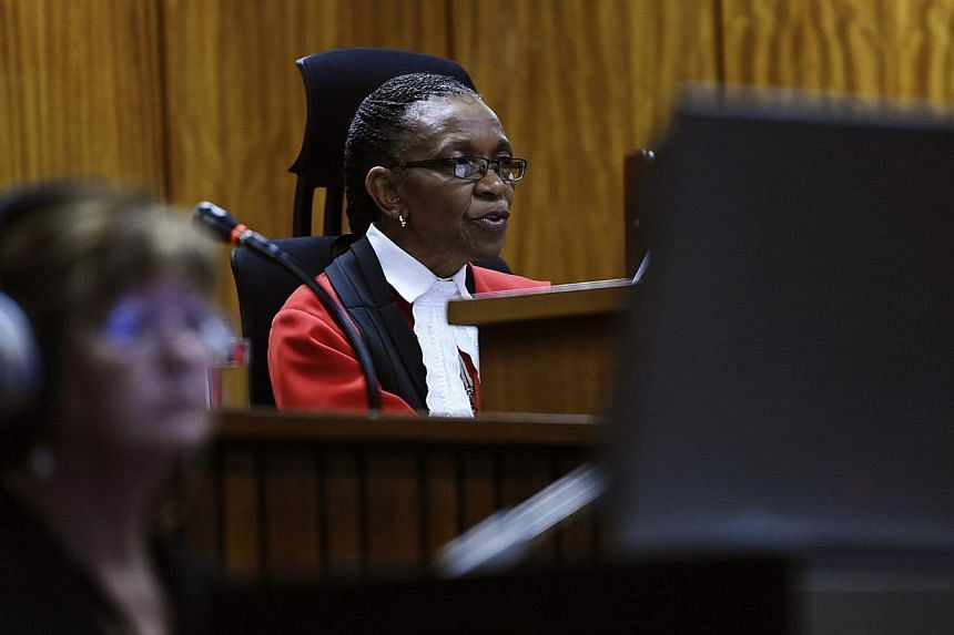 Judge Thokozile Masipa delivers her judgement in the trial of Olympic and Paralympic track star Oscar Pistorius at the North Gauteng High Court in Pretoria on Sept 11, 2014. -- PHOTO: REUTERS