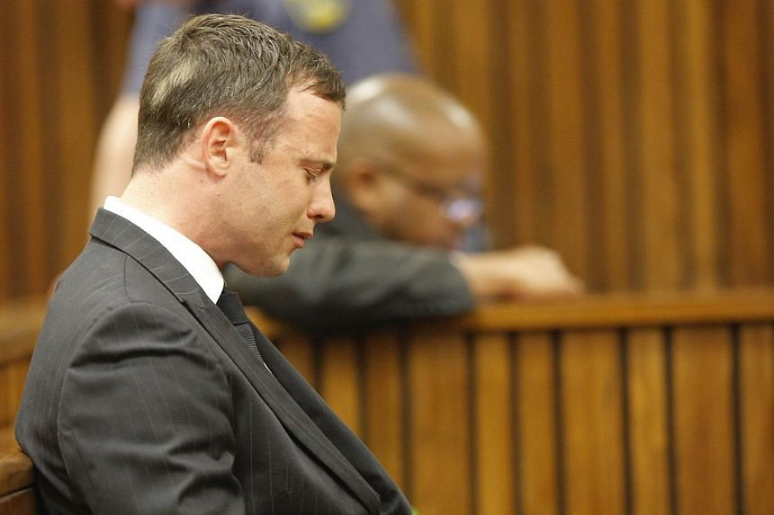 South African Paralympic athlete Oscar Pistorius cries in the dock during the verdict in his murder trial, Pretoria, South Africa on Sept 11, 2014. -- PHOTO: AFP