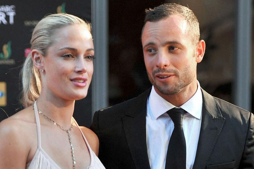 Oscar Pistorius and his girlfriend Reeva Steenkamp during the Feather Awards held at Melrose Arch in Johannesburg on Nov 4, 2012. -- PHOTO: AFP