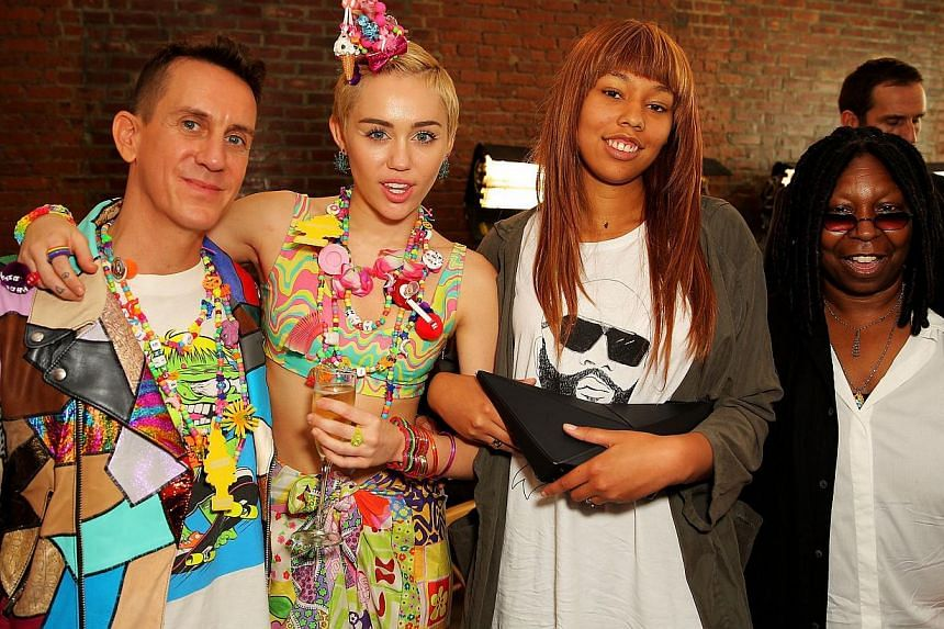 Designer Jeremy Scott, Miley Cyrus, Jerzey Dean and Whoopie Goldberg pose baskstage at Jeremy Scott fashion show during MADE Fashion Week Spring 2015 at Milk Studios in New York City on Sept 10, 2014. -- PHOTO: AFP