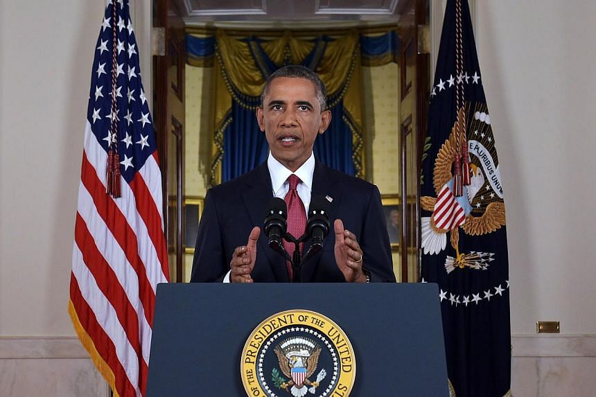 US President Barack Obama delivers a primetime address from the Cross Hall of the White House on Sept 10, 2014, in Washington, DC. -- PHOTO: AFP