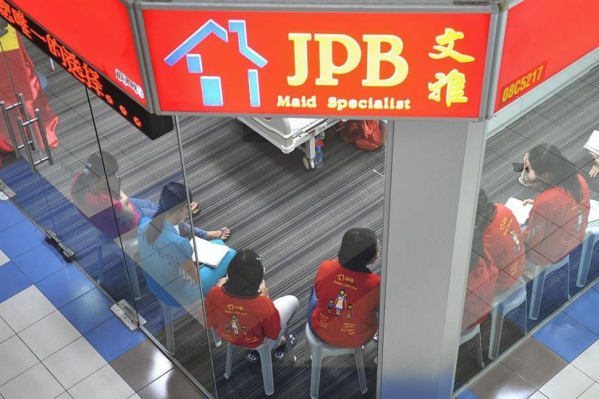 NOW: At JPB Maid Specialist at Bukit Timah Shopping Centre, maids who are undergoing training can be seen seated inside the maid agency.