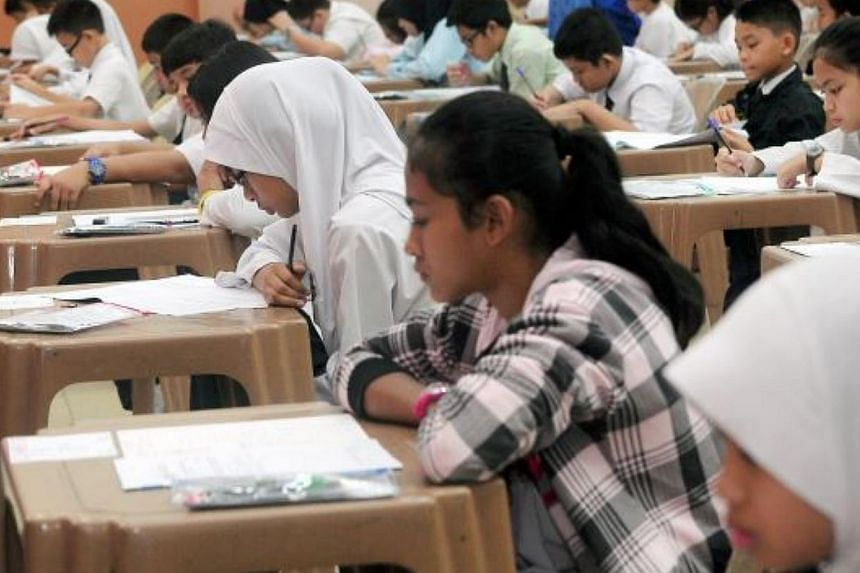 Pupils taking a USPR examination. Malaysia's Education Ministry is grappling with leaks in two papers in the key examination. -- PHOTO: THE STAR/ASIA NEWS NETWORK