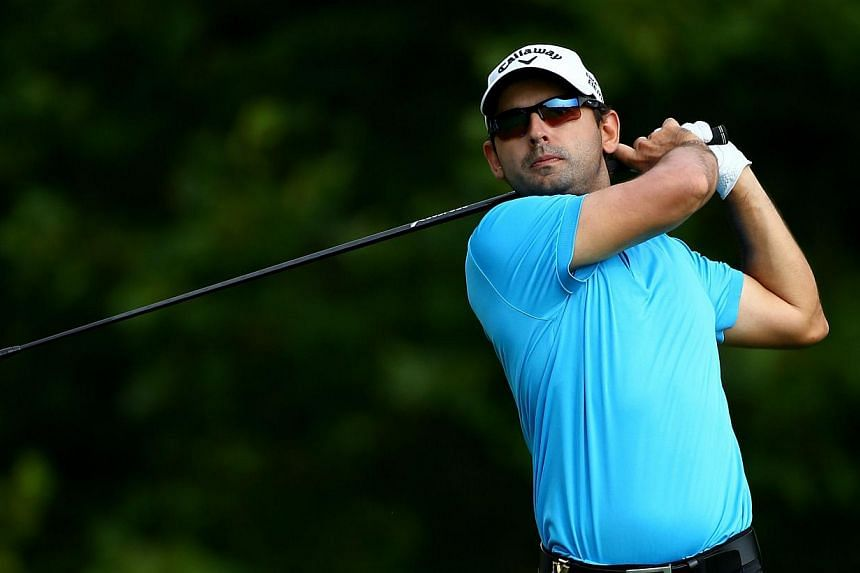 Fabrizio Zanotti of Paraguay hits a tee shot during a practice round prior to the start of the 96th PGA Championship at Valhalla Golf Clubon Aug 5, 2014 in Louisville, Kentucky. -- PHOTO: AFP