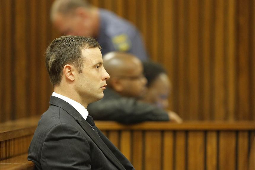 """""""Blade Runner"""" Oscar Pistorius sat weeping in the dock on Thursday as a judge began handing down the verdict over the Valentine's Day killing of the star Paralympian's model lover. -- PHOTO: AFP"""