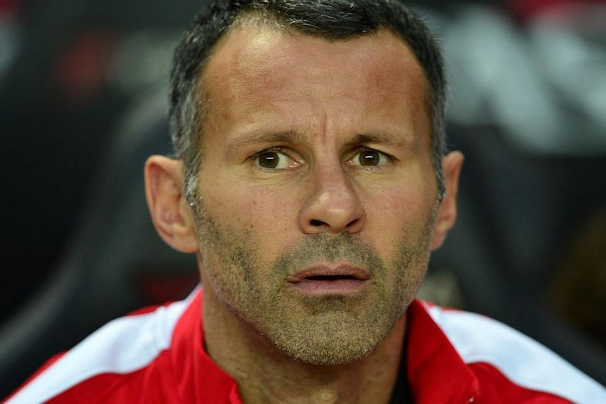 Ryan Giggs reassured Manchester United fans on Wednesday, Sept 10, 2014, that the club's commitment to youth development remains intact. -- PHOTO: AFP