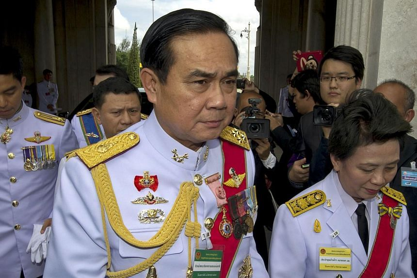 Head of the National Council for Peace and Order and army chief General Prayut Chan-O-Cha (centre) upon his arrival prior the opening of the National Legislative Assembly in Bangkok on Aug 7, 2014. -- PHOTO: AFP