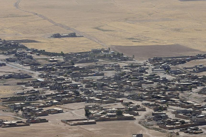 A general view shows Baretle village, which is controlled by the Islamic State (IS), in Khazir, on the edge of Mosul Sept 8, 2014. IS militants in Iraq and Syria now have about 20,000 to 31,500 fighters on the ground, says the CIA. -- PHOTO: REUTERS