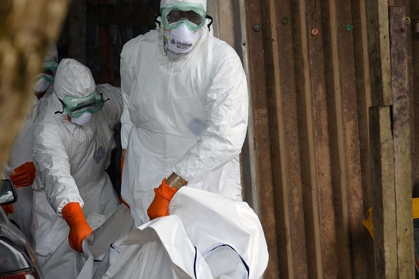 The Red Cross said on Thursday it planned to train more than 2,000 extra volunteers to step up its response to the deadly Ebola outbreak ravaging west Africa. -- PHOTO: AFP