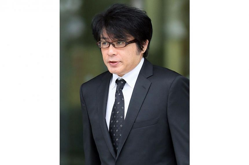 Japanese pop singer Aska, who was released on bail at a Tokyo police station on July 3, 2014.He was convicted on Friday of using illegal drugs in his apartment in Tokyo, and was handed a suspended jail sentence. -- PHOTO: AFP