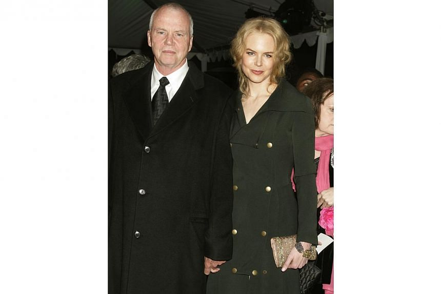 Actress Nicole Kidman is escorted by her father, Dr Anthony Kidman as she arrives at the 2005 Palm Springs Film Festival Gala dinner in Palm Springs, California on Jan 8, 2005. -- PHOTO: REUTERS
