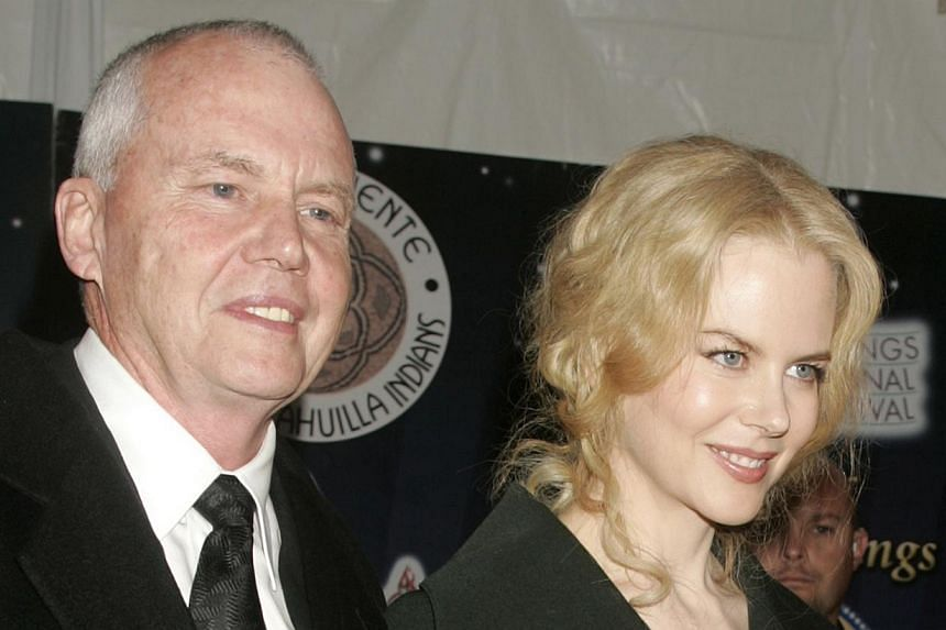 Actress Nicole Kidman is escorted by her father, Dr Antony Kidman, as she arrives at the 2005 Palm Springs Film Festival Gala dinner in Palm Springs, California in this Jan 8, 2005, file photo. -- PHOTO: REUTERS