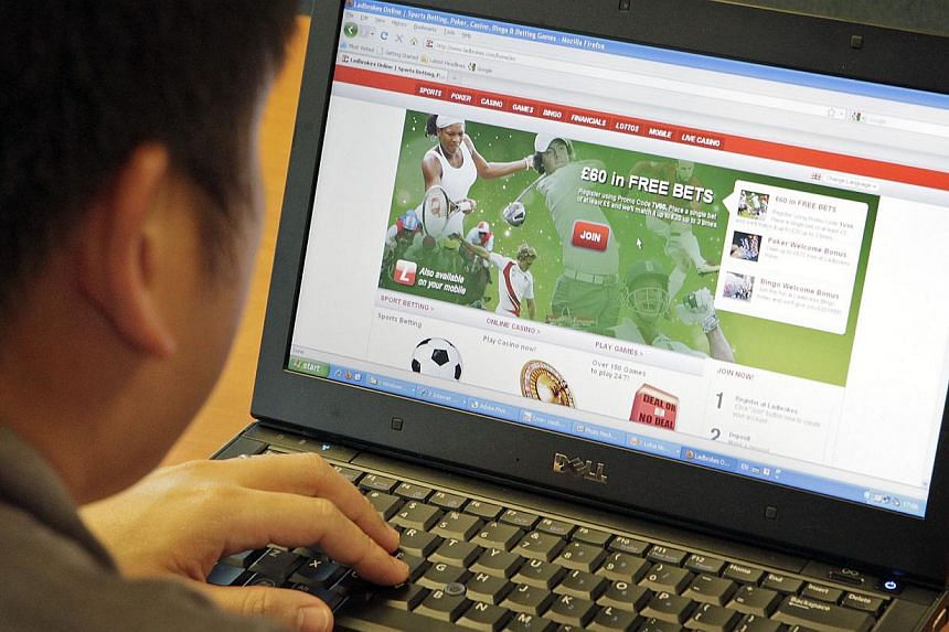 A man looking at an online sports betting site.An online counselling service for gamblers is being tested by the authorities as lawmakers mull over the proposed Bill to curb online gambling. -- PHOTO: ST FILE