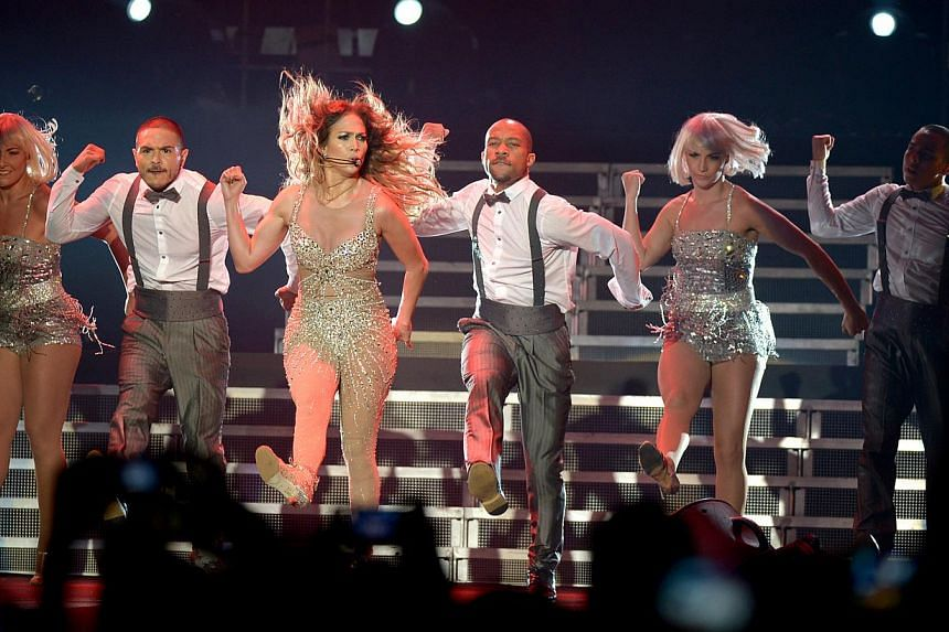 This year, that slot goes to pop sensation and Hollywood actress Jennifer Lopez (above centre). -- PHOTO: ST FILE