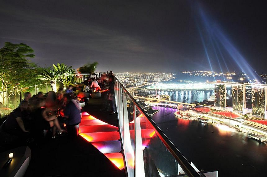 Enjoy the 360-degree rooftop view, with 70 per cent visibility of the track from the 63rd floor at 1-Altitude. -- PHOTO: 1-ALTITUDE