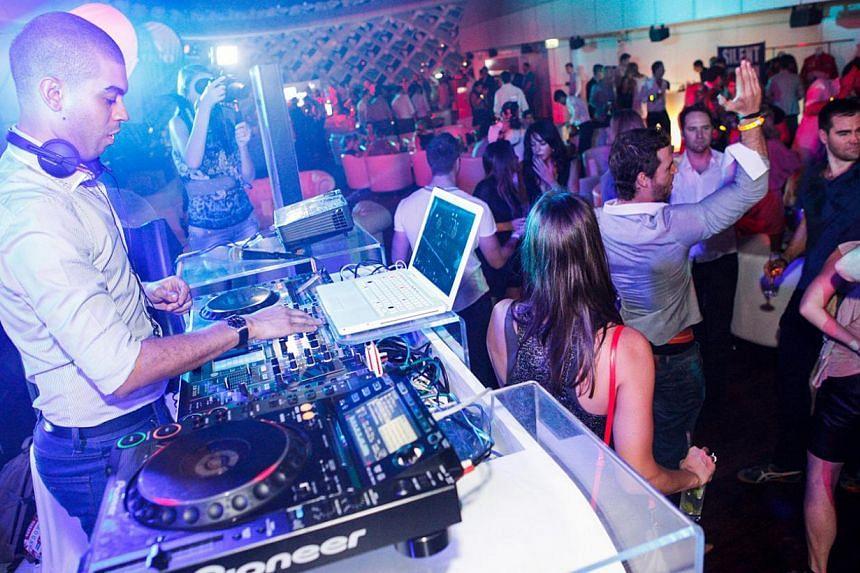 Dance with English DJ Miles Slater at Podium Lounge. -- PHOTO: PODIUM LOUNGE