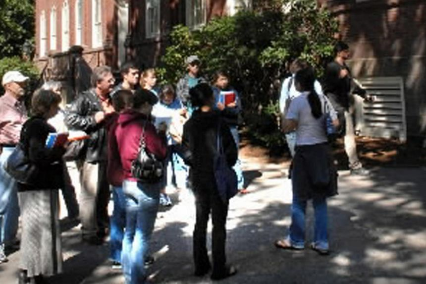 Prospective students and their parents taking a tour of Harvard University. Four in five Singapore parents would consider sending their children abroad for further studies, even though many believe the quality of education is better here than in most