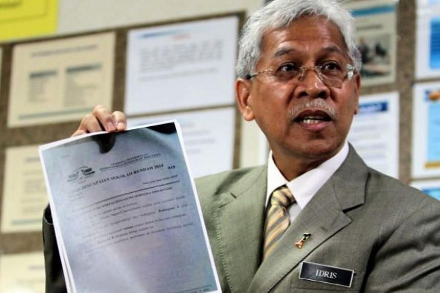 Malaysia's Second Education Minister Datuk Seri Idris Jusoh speaking at a press conference at the Malaysian Examinations Syndicate in Putrajaya on Friday. -- PHOTO: THE STAR/ASIA NEWS NETWORK