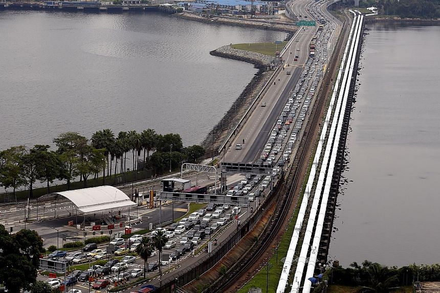 Singapore will revise its toll charges at the Causeway to match those of Malaysia. -- PHOTO: ST FILE