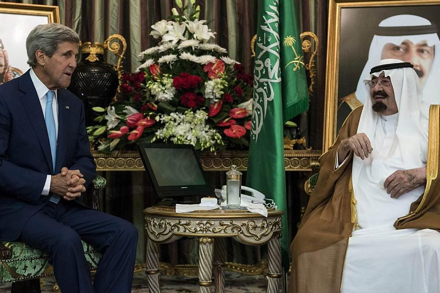 Saudi King Abdullah bin Abdul Aziz al-Saud (R) and US Secretary of State John Kerry talk before a meeting at the Royal Palace on September 11, 2014 in Jeddah, Saudi Arabia. Kerry and regional counterparts have started talks in Saudi Arabia on forming