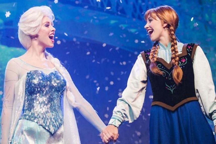 Actresses dressed as Disney characters Elsa (left) and Anna from the movie Frozen. -- PHOTO: DISNEY