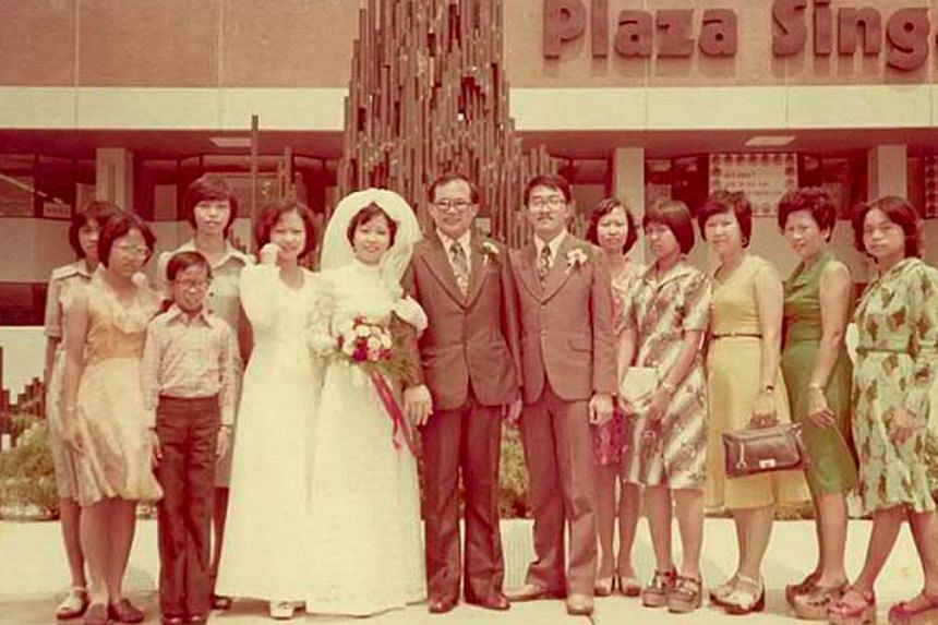 Hong Kong's one-Michelin-star restaurant Tim Ho Wan opened an outlet (above) at The Atrium@Orchard in April last year and draws queues for its dim sum. Groom Hsien Yong Seng (seventh from left) in a 1975 wedding picture taken outside Plaza Singapura.