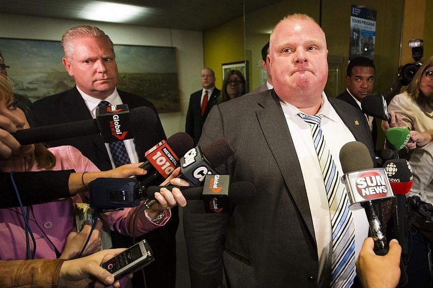 Toronto Mayor Rob Ford (right), who gained global notoriety for admitting he smoked crack cocaine, dropped his re-election bid on Friday, citing a health crisis, but his older brother Doug (left) took his place in the race to run Canada's largest cit