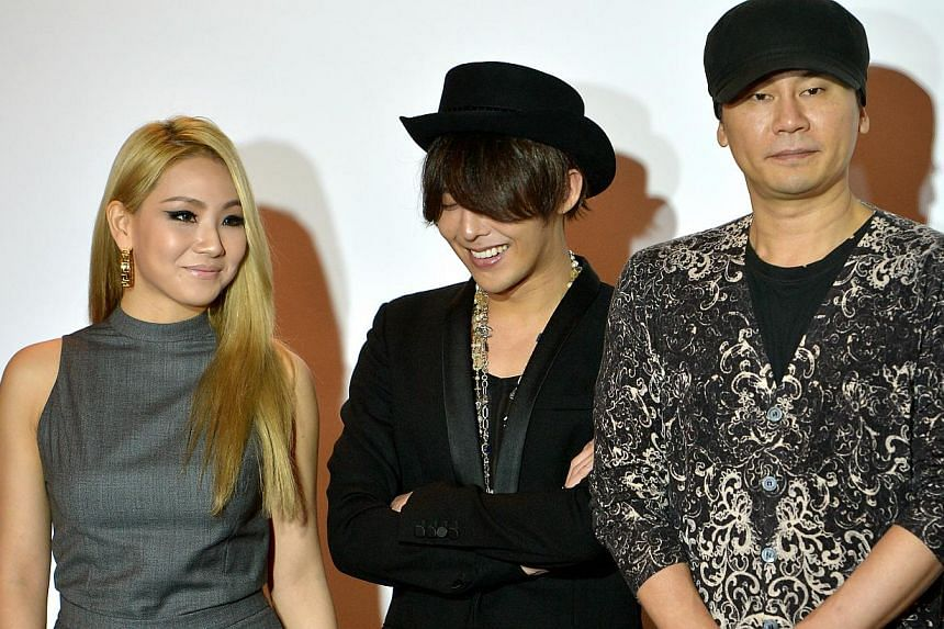 (From left) CL of K-pop girl group 2NE1, G-Dragon and YG Entertainment founder and chairman Yang Hyun Suk. -- ST PHOTO: KUA CHEE SIONG