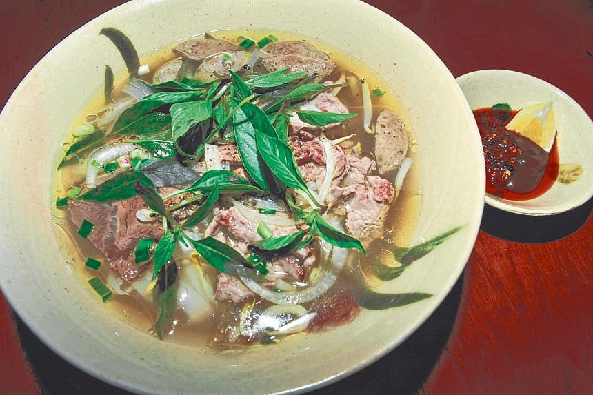 At Moc Quan, enjoy Pho Bo with sliced beef, brisket and beef meat balls (above) and banh mi made with freshly baked baguettes. -- ST PHOTO: RUDY WONG