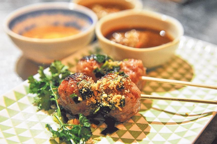 Mrs Pho, run by owners Hoang Ha, 35, and Darien Tan, 37, and executive chef Kim Anh, 48, serves Viet delights such as pho and meat balls (above). -- ST PHOTO: RUDY WONG