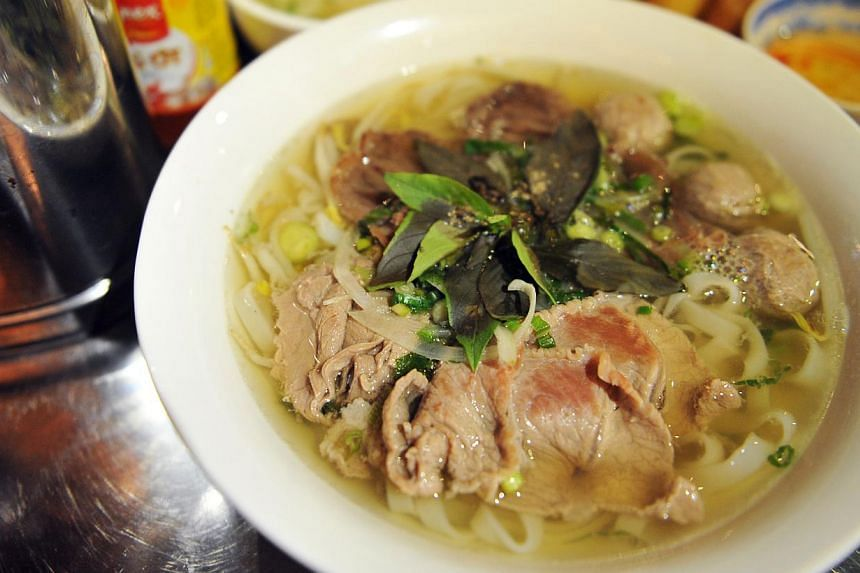 Mrs Pho, run by owners Hoang Ha, 35, and Darien Tan, 37, and executive chef Kim Anh, 48, serves Viet delights such as pho (above) and meat balls. -- ST PHOTO: RUDY WONG