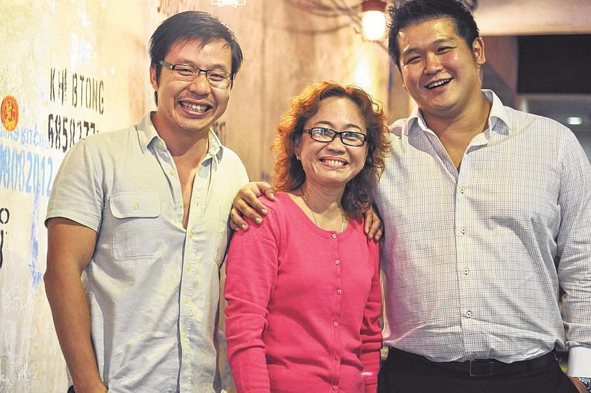 Mrs Pho, run by owners Hoang Ha (left), 35, and Darien Tan (right), 37, and executive chef Kim Anh (centre), 48, serves Viet delights such as pho and meat balls. -- ST PHOTO: RUDY WONG