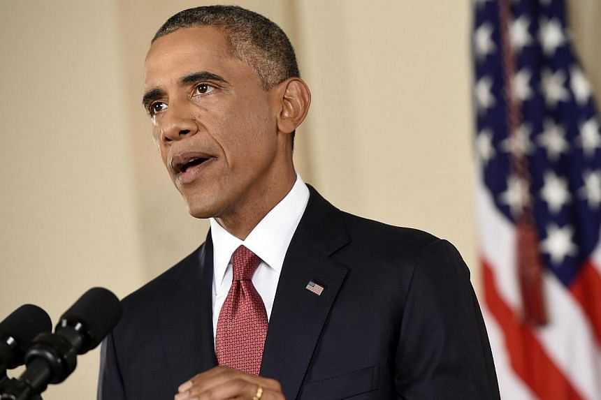 """US President Barack Obama on Saturday strongly condemned """"the barbaric murder"""" of Briton David Haines by Islamic State in Iraq and Syria (ISIS) militants after the group released a video purporting to show the beheading of the aid worker. -- PHOTO: R"""