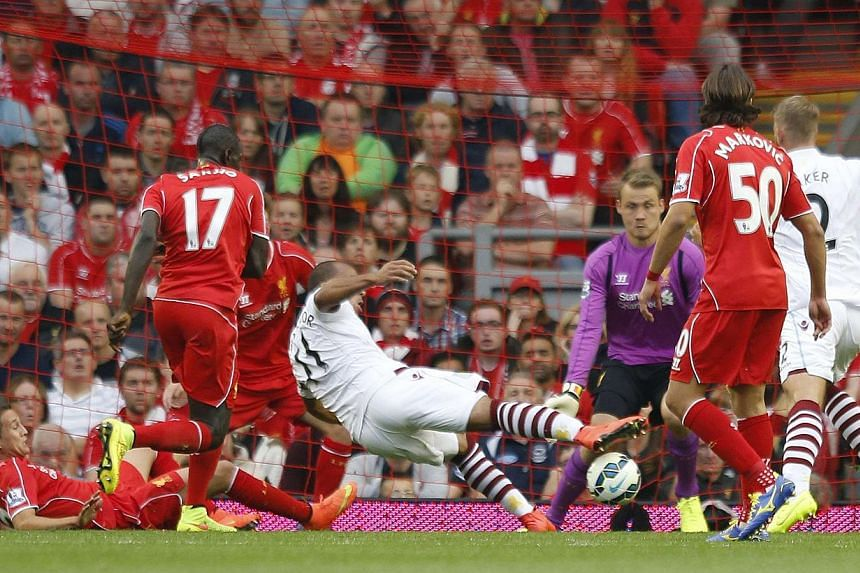 Aston Villa's Gabriel Agbonlahor (centre) scores a goal during their English Premier League soccer match against Liverpool at Anfield in Liverpool, northern England on Sept 13, 2014. -- PHOTO: REUTERS