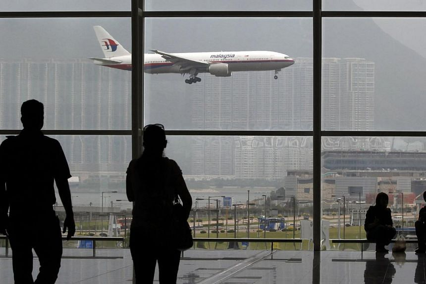 A Malaysia Airlines Boeing 777 plane is seen from the departure hall at the Hong Kong International Airport, in this June 2, 2011 file photo. -- PHOTO: REUTERS