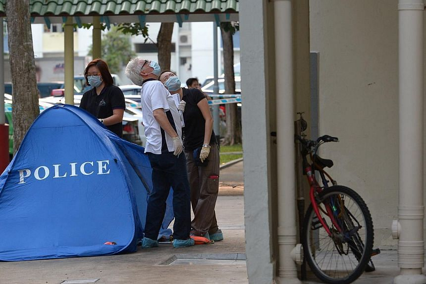 Police suspect foul play after a boy fell to his death at Blk 815, Tampines Avenue 4.The mother of the seven-year-old boy found dead at the foot of a Tampines HDB block has been arrested for murder.-- ST PHOTO:NG SOR LUAN