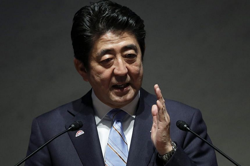 """Japanese Prime Minister Shinzo Abe said on Sunday he remained """"neutral"""" on whether to proceed with a hike in Japan's sales tax to 10 per cent, adding that decision would hinge on the strength of economic indicators for the current quarter. -- PHOTO:"""